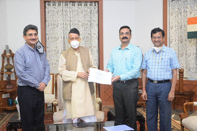 Hon Director presenting a copy of Presentation on NEP2020 to Hon Governor Maharashtra during the meeting on NEP2020 at Rajbhavan on 27/8/2020. Other dignitaries present are : Shri Rajiv Jalota , ACS HTED, GoM and Shri Santosh Kumar , PRincipal a Secretary, Governor Secretariat .